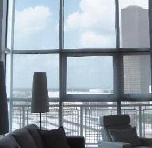 Motorized window coverings custom drapes interior shades for Motorized solar shades for windows